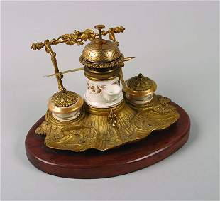 A French Gilt Metal and Porcelain Pump Inkwell an