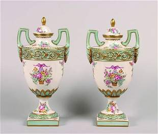 A Pair of French Porcelain Urns.