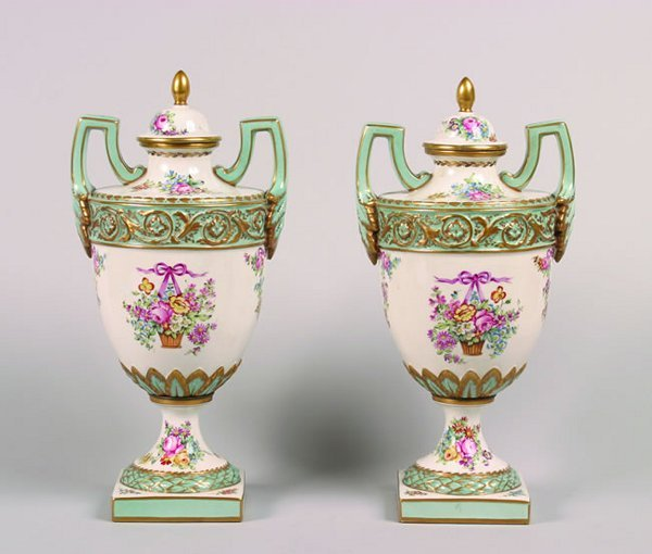 1142: A Pair of French Porcelain Urns.