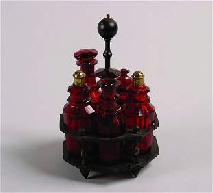 An English Cranberry Cruet Set,
