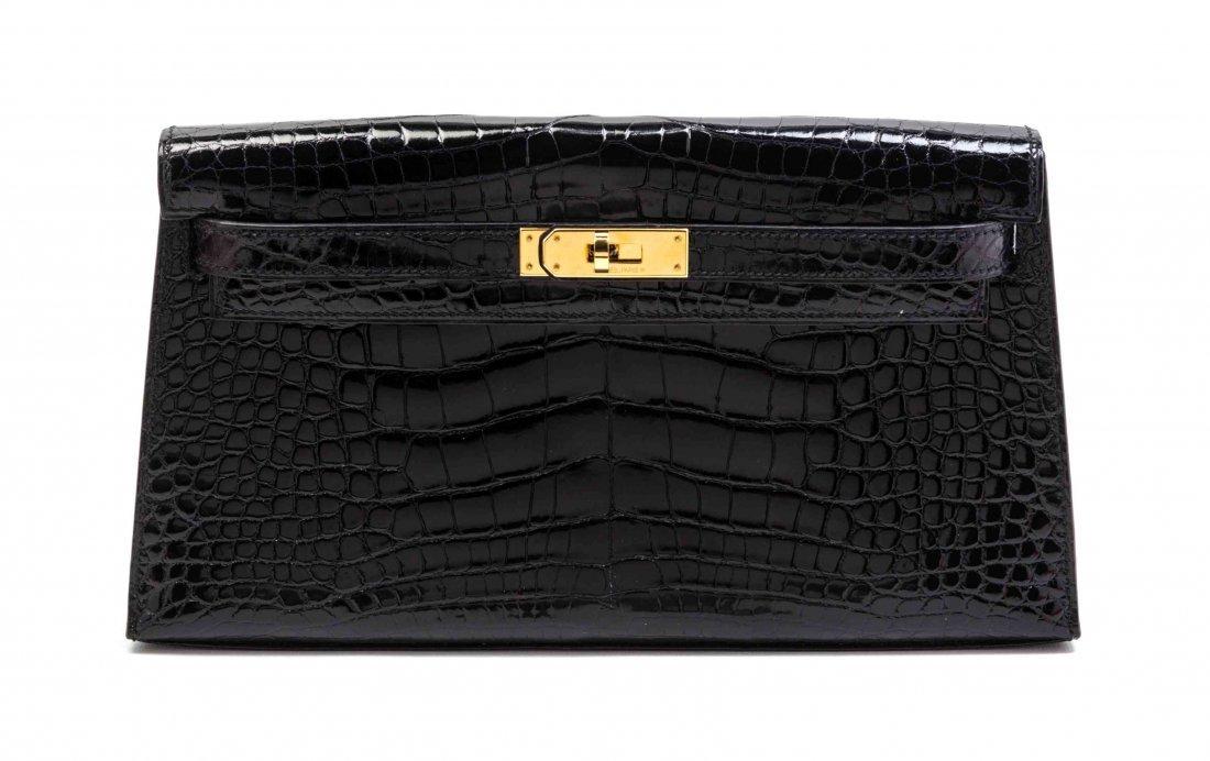 An Hermes Black Shiny Alligator Kelly Clutch Bag, 11 x