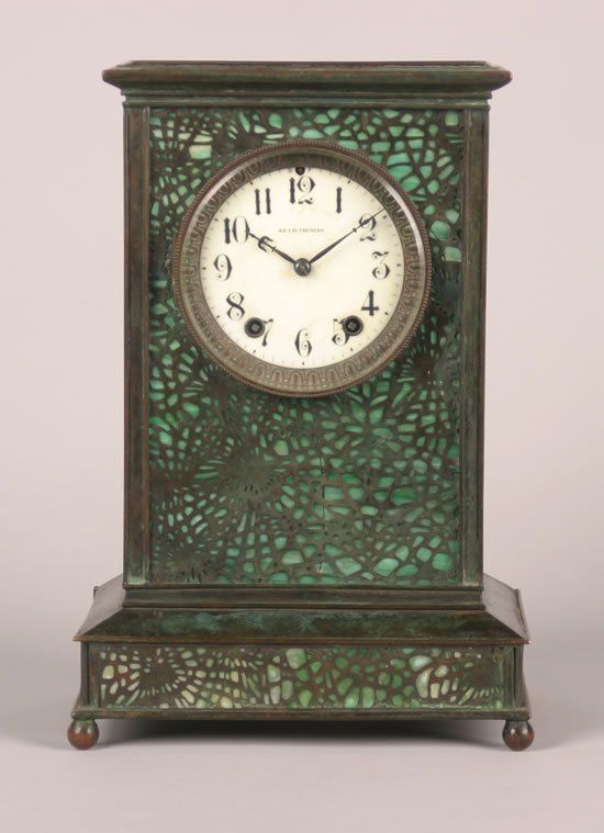 A Tiffany Studios Glass and Bronze Overlay Mantle