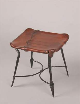 A Wrought Iron and Leather Lined Stool,