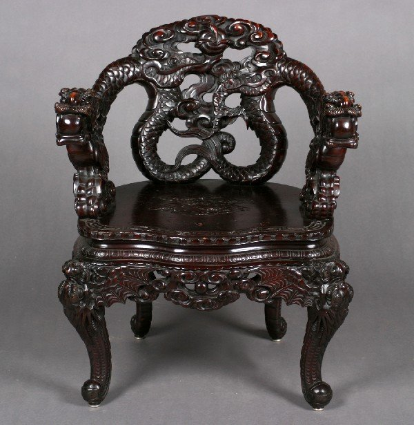 516: A Chinese Carved Hardwood Armchair, Height 34 x wi