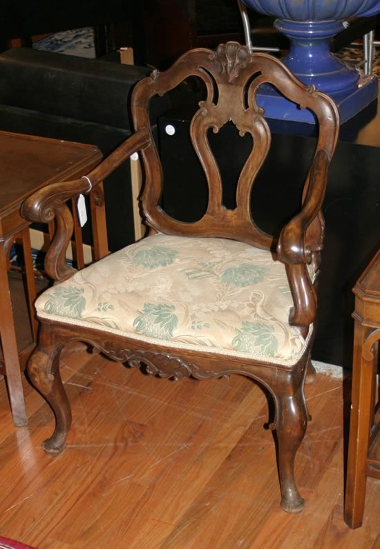 488: A Louis XV Style Carved Walnut Open Armchair.