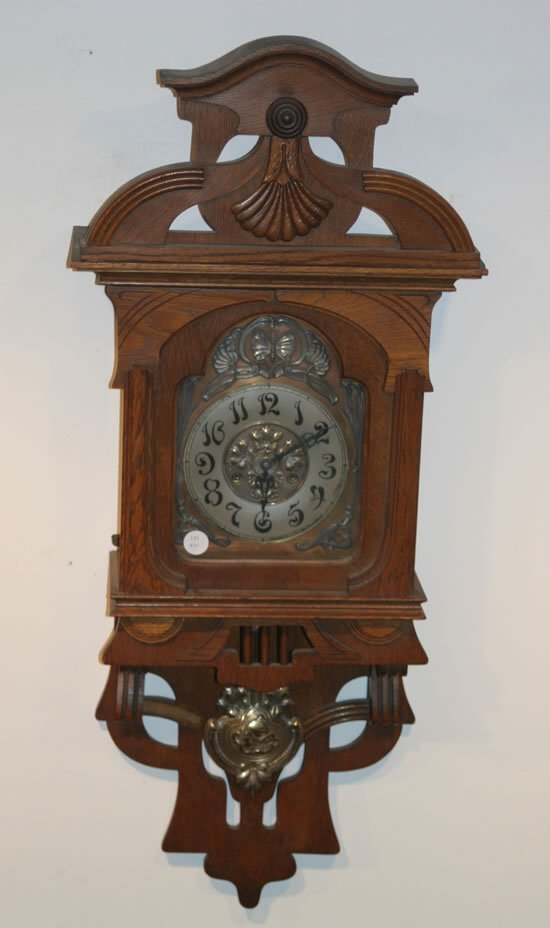502: A Carved Oak Wall Clock,