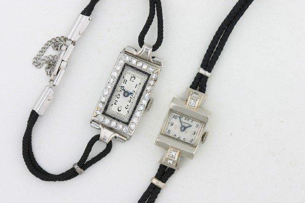 8: A Lady's Platinum, Diamond and Black Onyx Art Deco W