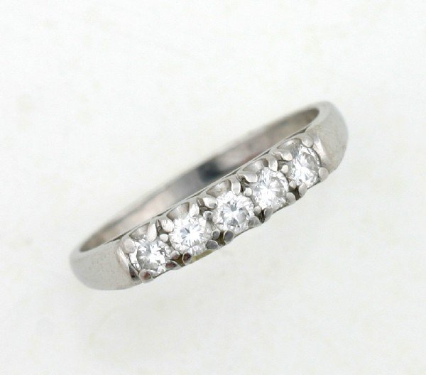 9: A Lady's Platinum and Diamond Ring,