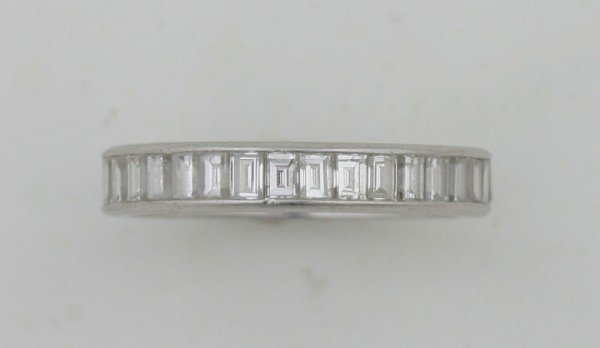 16: A Lady's Platinum and Diamond Eternity Ring,