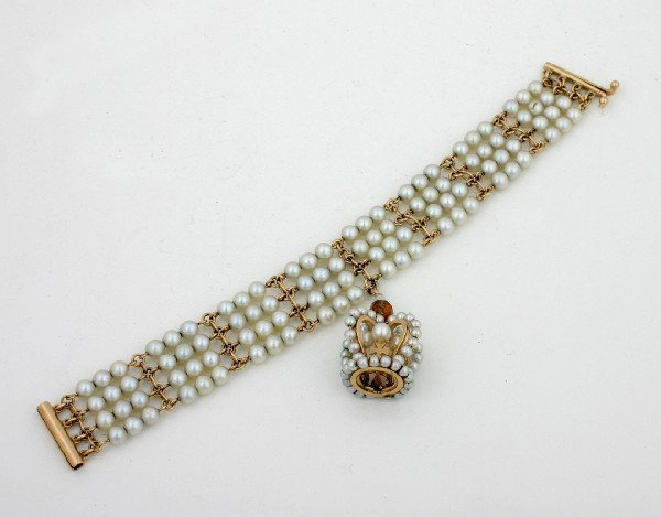 19: A Lady's Four Strand 14 Karat Yellow Gold and Cultu