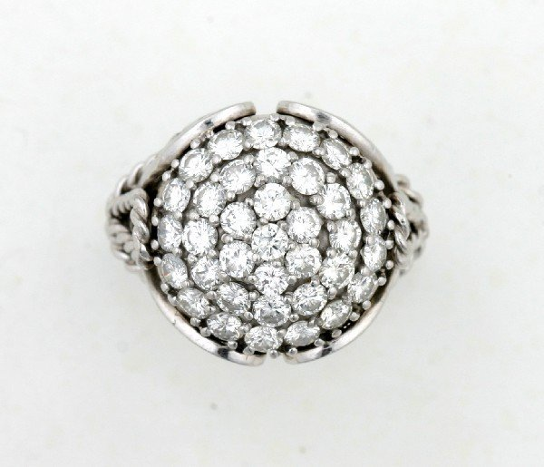23: A Lady's Platinum and Diamond Ring,