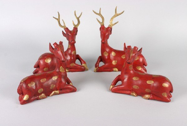 423: A Group of Four Painted and Gilded Figures of Deer