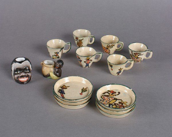 426: A Set of Six Ceramic Demitasse Cups and Saucers,