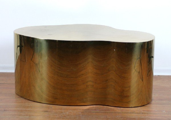 827: A Pair of Shaped Brass End Tables.