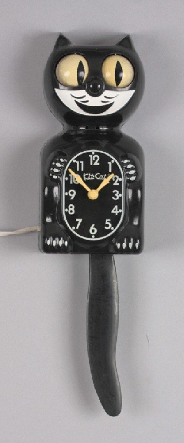 10A: Mancow: A Kit Cat Wall Clock,