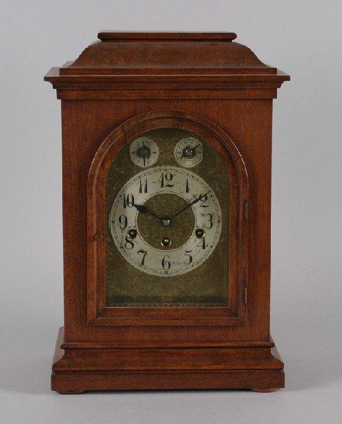 16B: A Mahogany Mantle Clock, Height 17 x width 11 x de