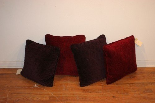 502B: A Group of Four Chenille Throw Pillows,