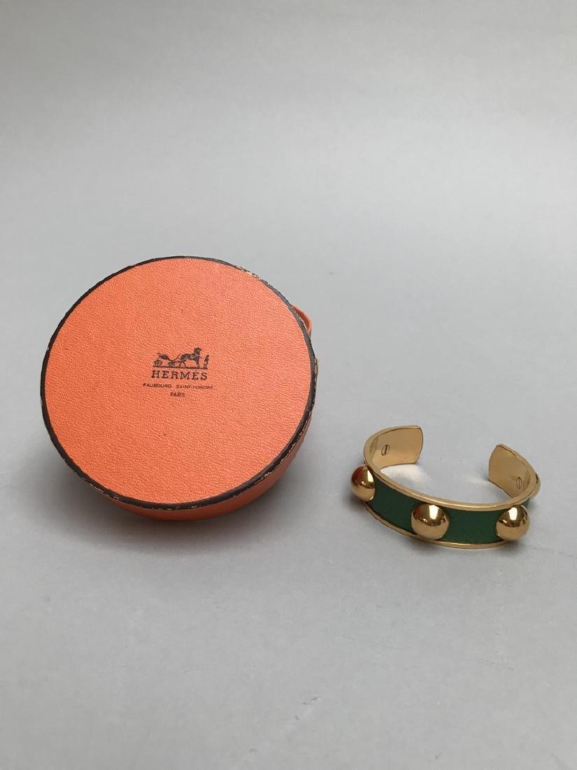 HERMES PARIS  BRACELET Rigide semi-ouvert en métal doré
