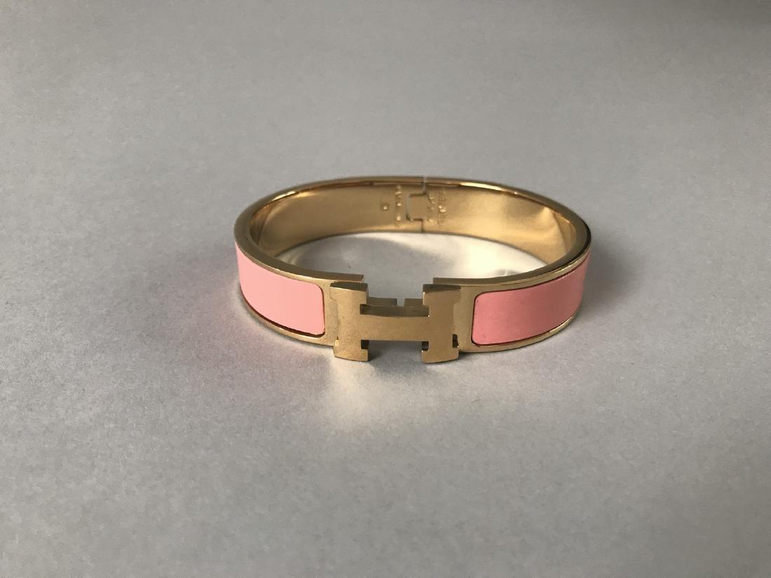 HERMES PARIS BRACELET Clic H en métal doré et laque