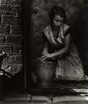 BILL BRANDT (1904-1983) Young housewife, Bethnal Green,