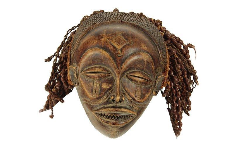 A Chokwe tribe Mwana-Po mask, Congo, half of the 20th
