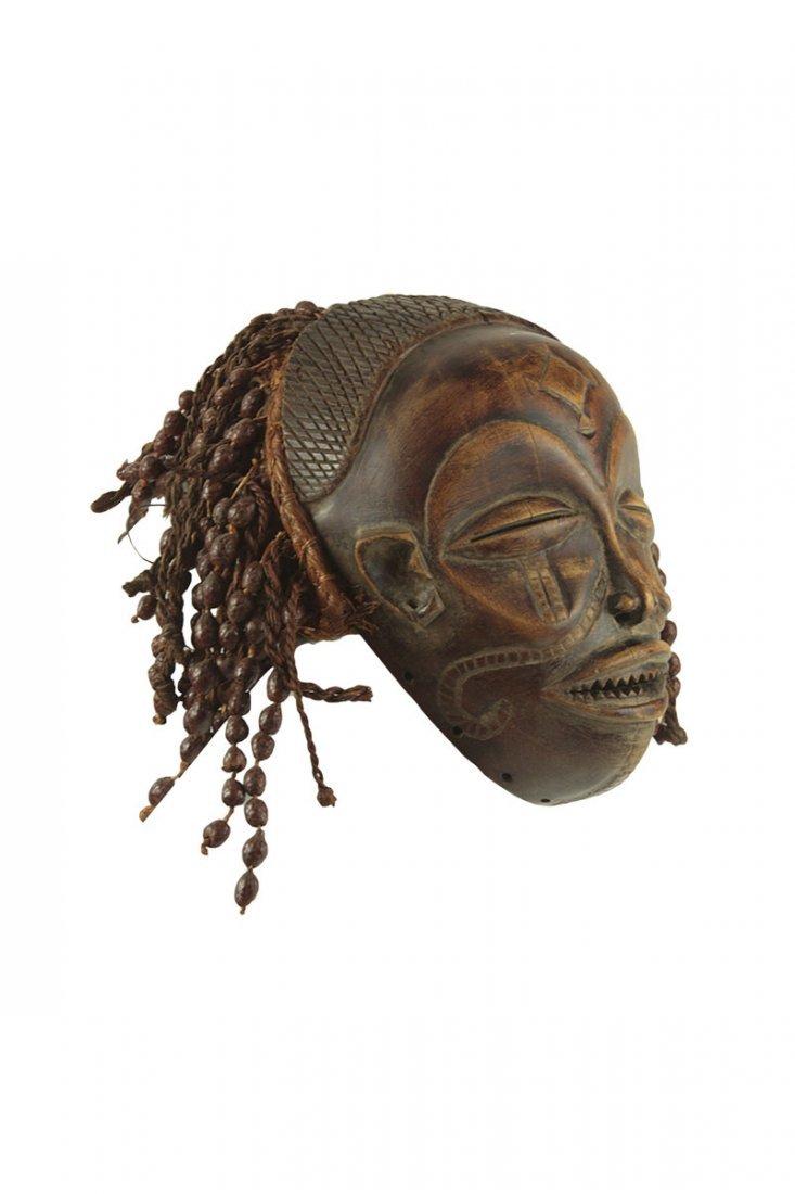 A Chokwe tribe Mwana-Po mask, Congo, half of the 20th - 2