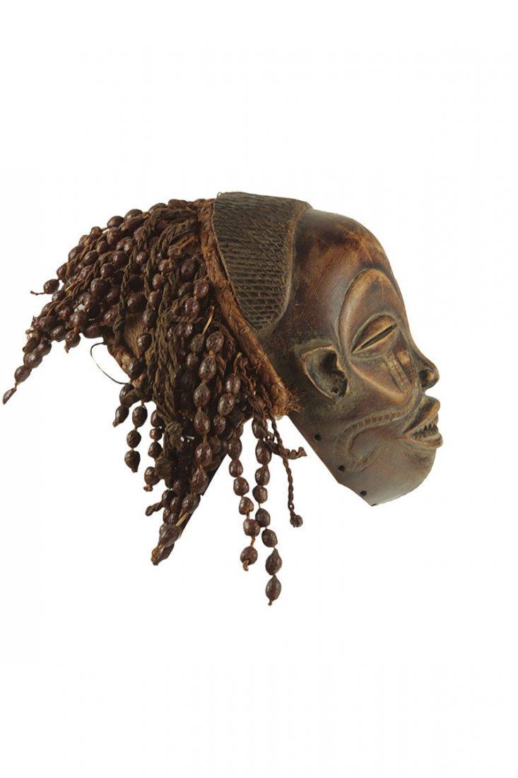 A Chokwe tribe Mwana-Po mask, Congo, half of the 20th - 3