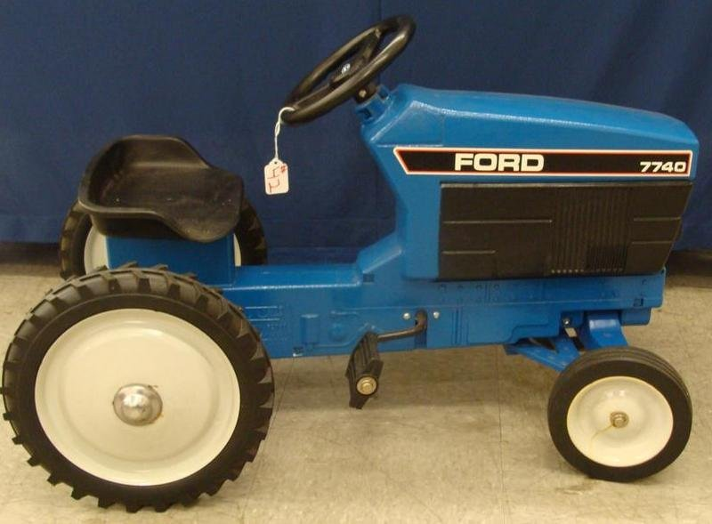 Signed ERTL Ford 7740 Chain Driven Pedal Tractor. Aucti