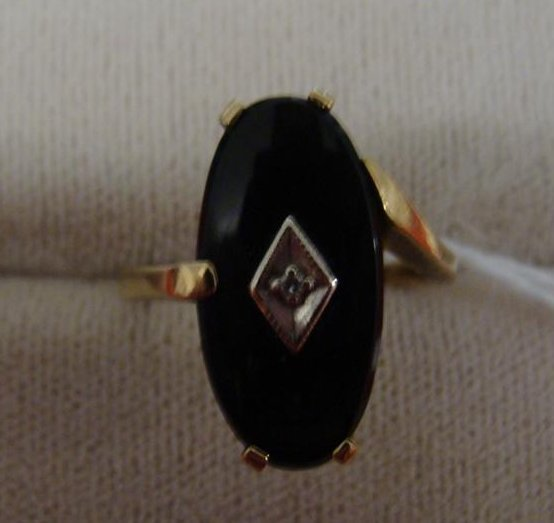10K Yellow Gold Onyx Ring with a Center Bezel Set