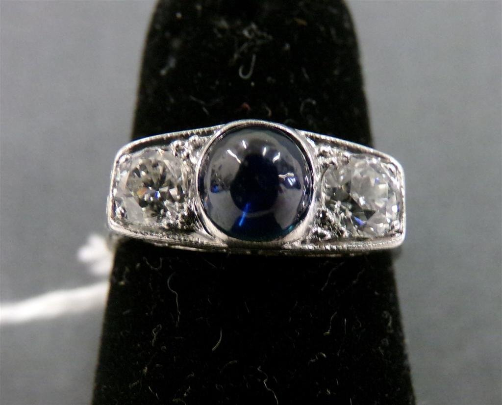 Antique Platinum Ring with Cabochon Sapphire Center