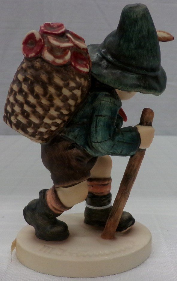 Hummel Figurine: Flower Vendor #381; TM 5. Book Value - 4