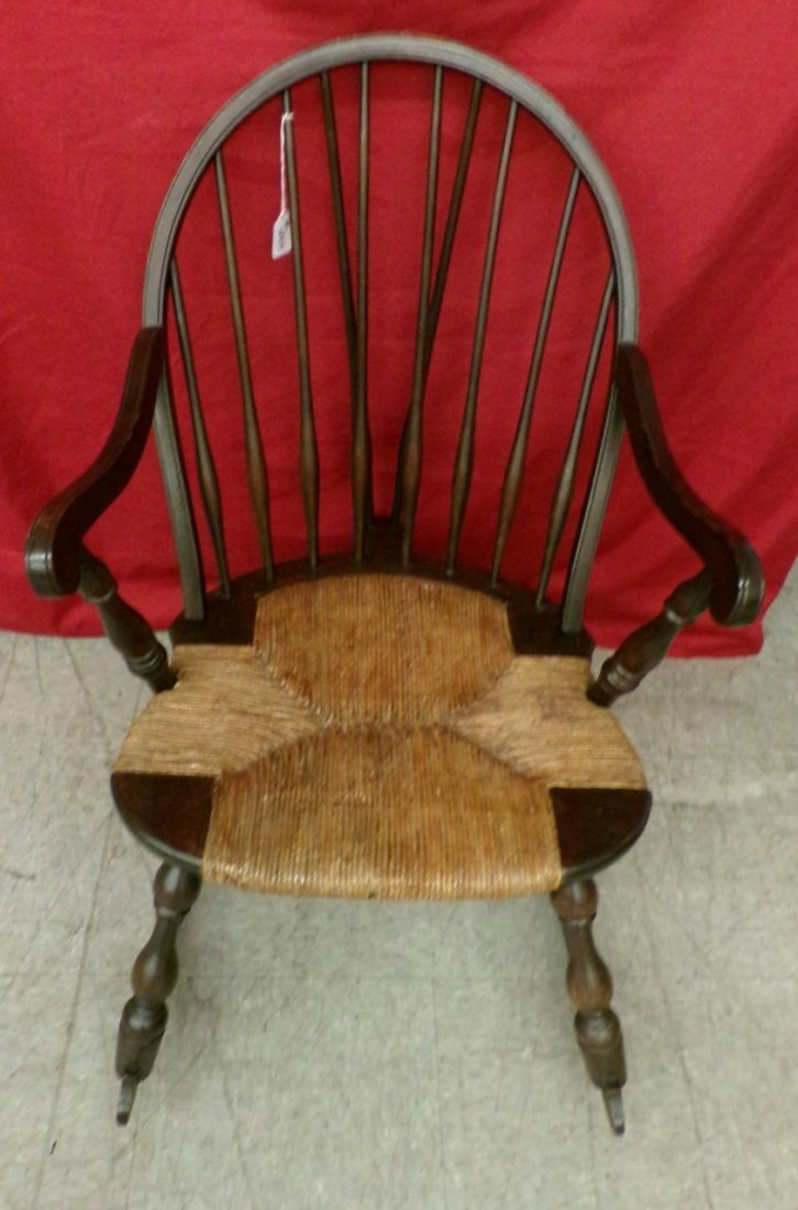 Antique Spindle Back Rocking Chair with a Rush Seat.