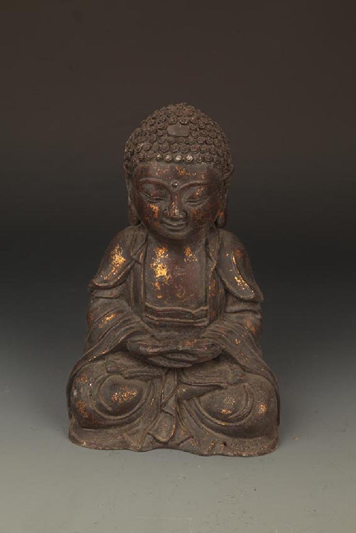 A FINELY CARVED CAST IRON TATHAGATA BUDDHA FIGURE