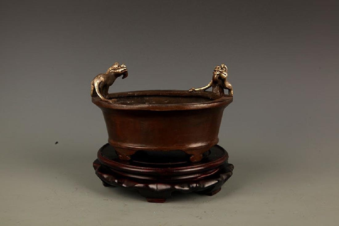 "A BRONZE ""LI HU"" FIGURE CENSER"