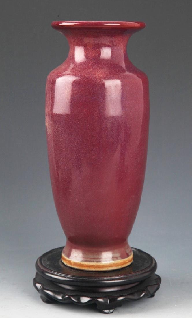 A LARGE RED COLOR PORCELAIN JAR