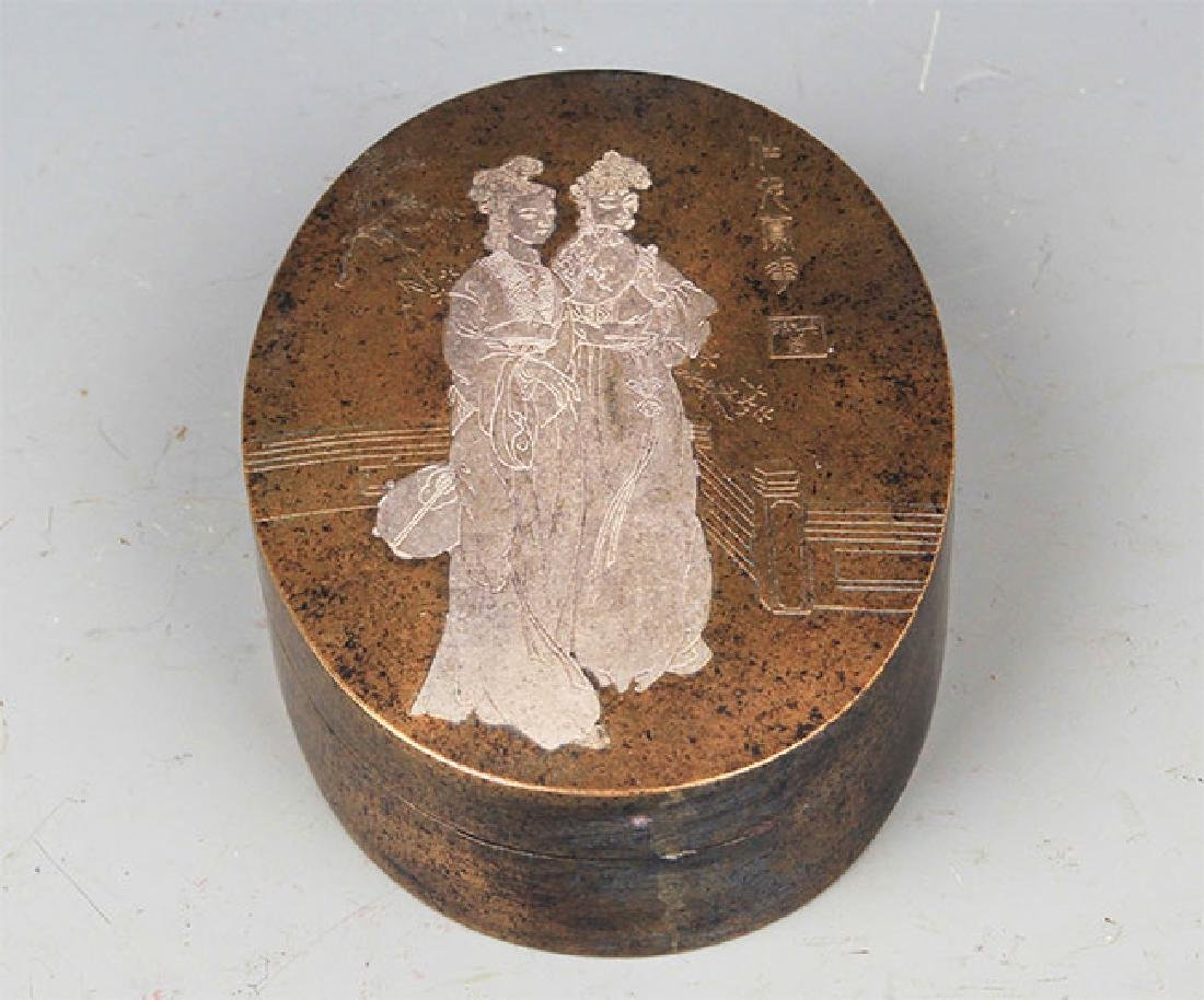 A FINELY CARVED ROUND BRONZE INK BOX