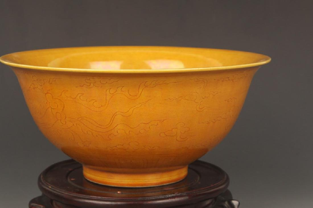 A YELLOW GROUND DRAGON CARVING PORCELAIN BOWL