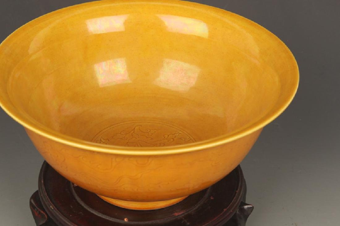 A YELLOW GROUND DRAGON CARVING PORCELAIN BOWL - 2