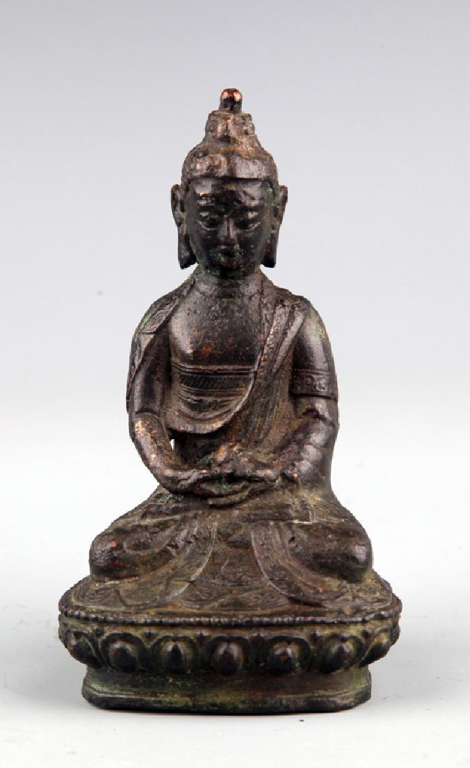 A FINELY CARVED BUDDHA FIGURE