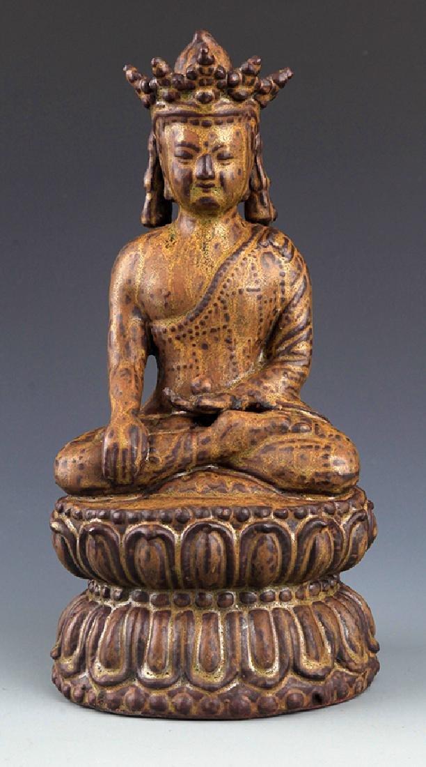 A LARGE CARVED BRONZE MEDICINE BUDDHA