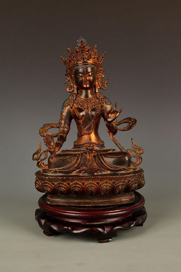 A LARGE TIBETAN BRONZE BUDDHA FIGURE