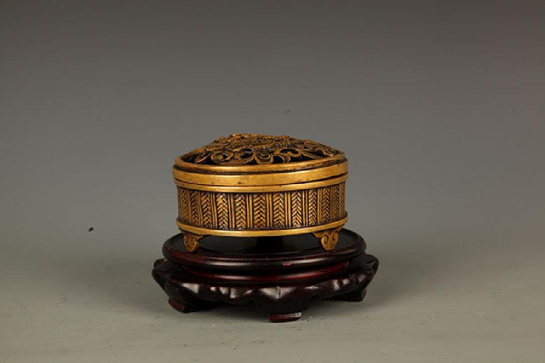 A DRAGON CARVING HOLLOW CARVED BRONZE HEATER