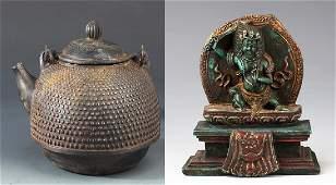 A FINE CAST IRON TEA POT AND TIBETIAN BUDDHA FIGURE