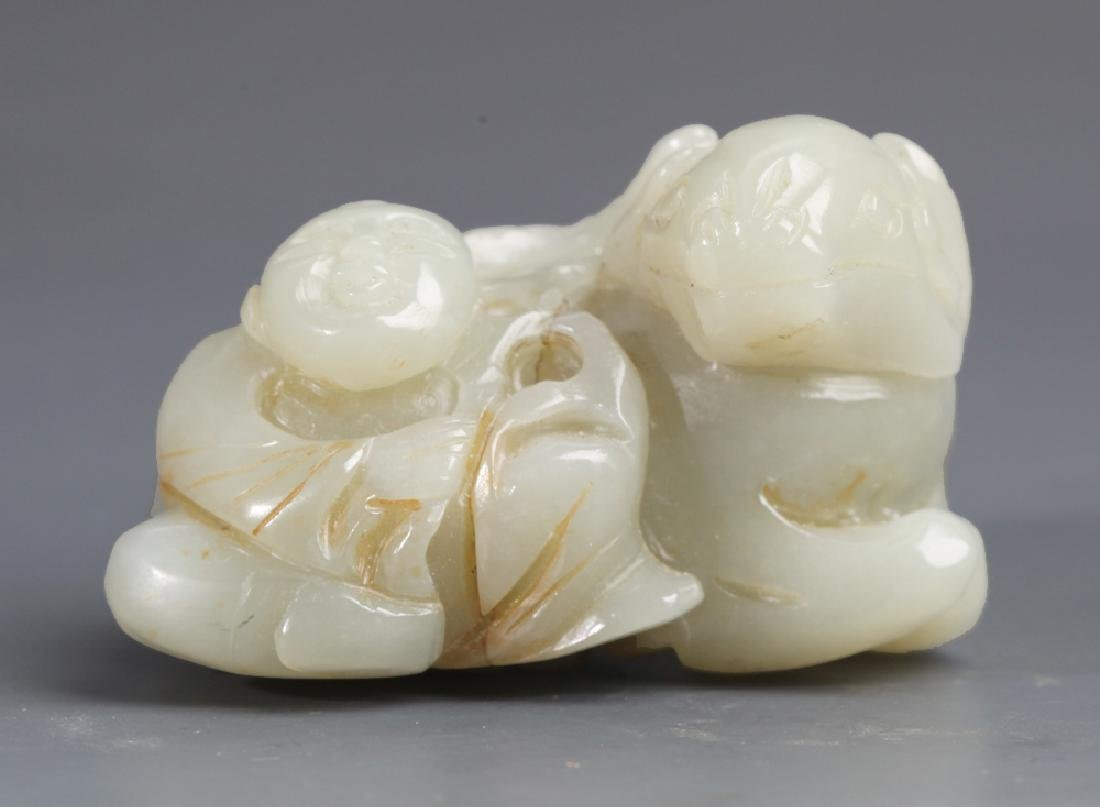 A CARVED WHITE JADE PENDANT IN FIGURE OF GRAZING
