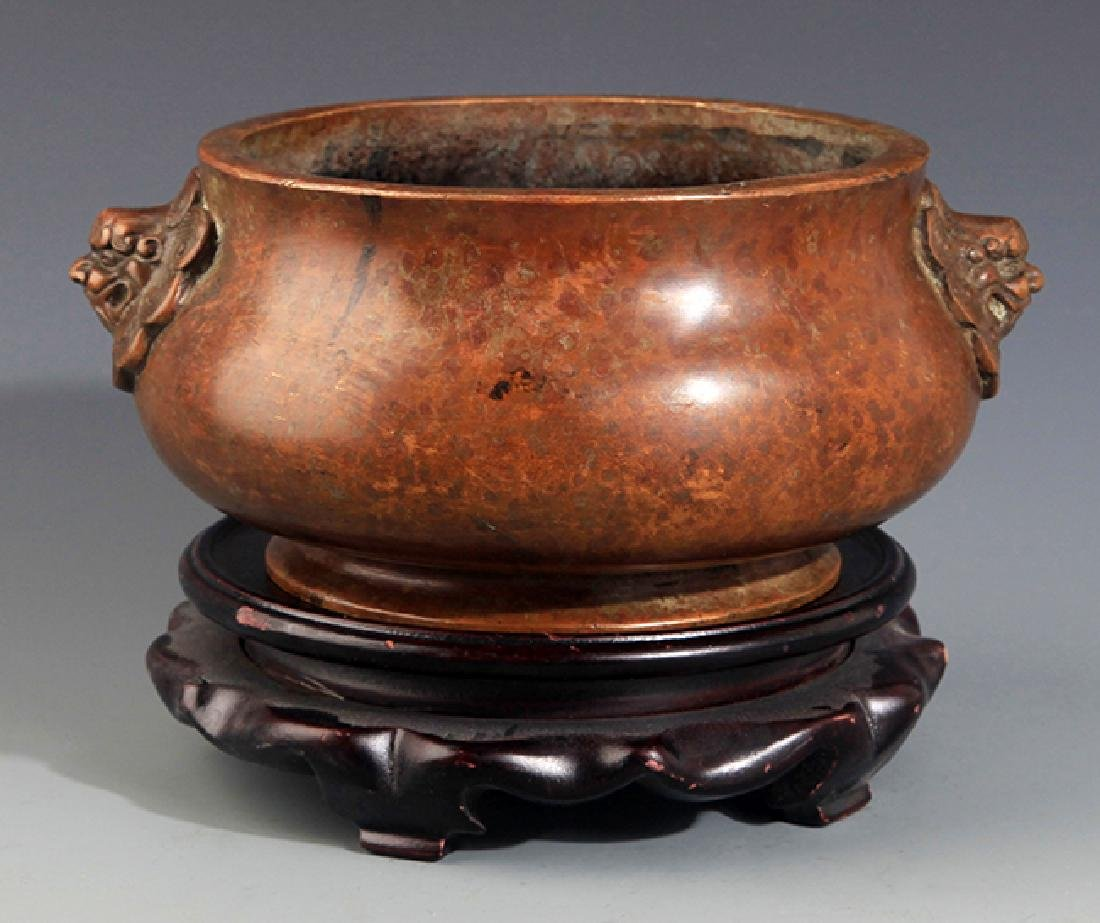A LION SHAPED HANDLE BRONZE CENSER