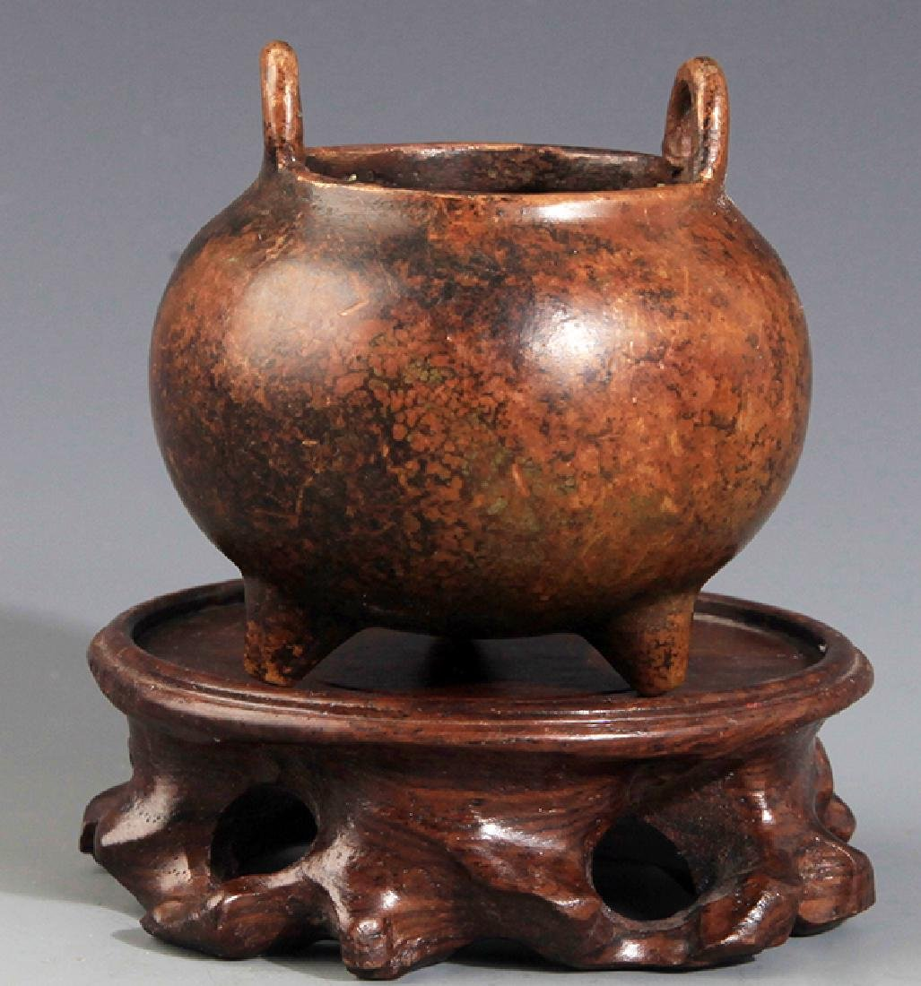 A ROUND DOUBLE EAR BRONZE CENSER
