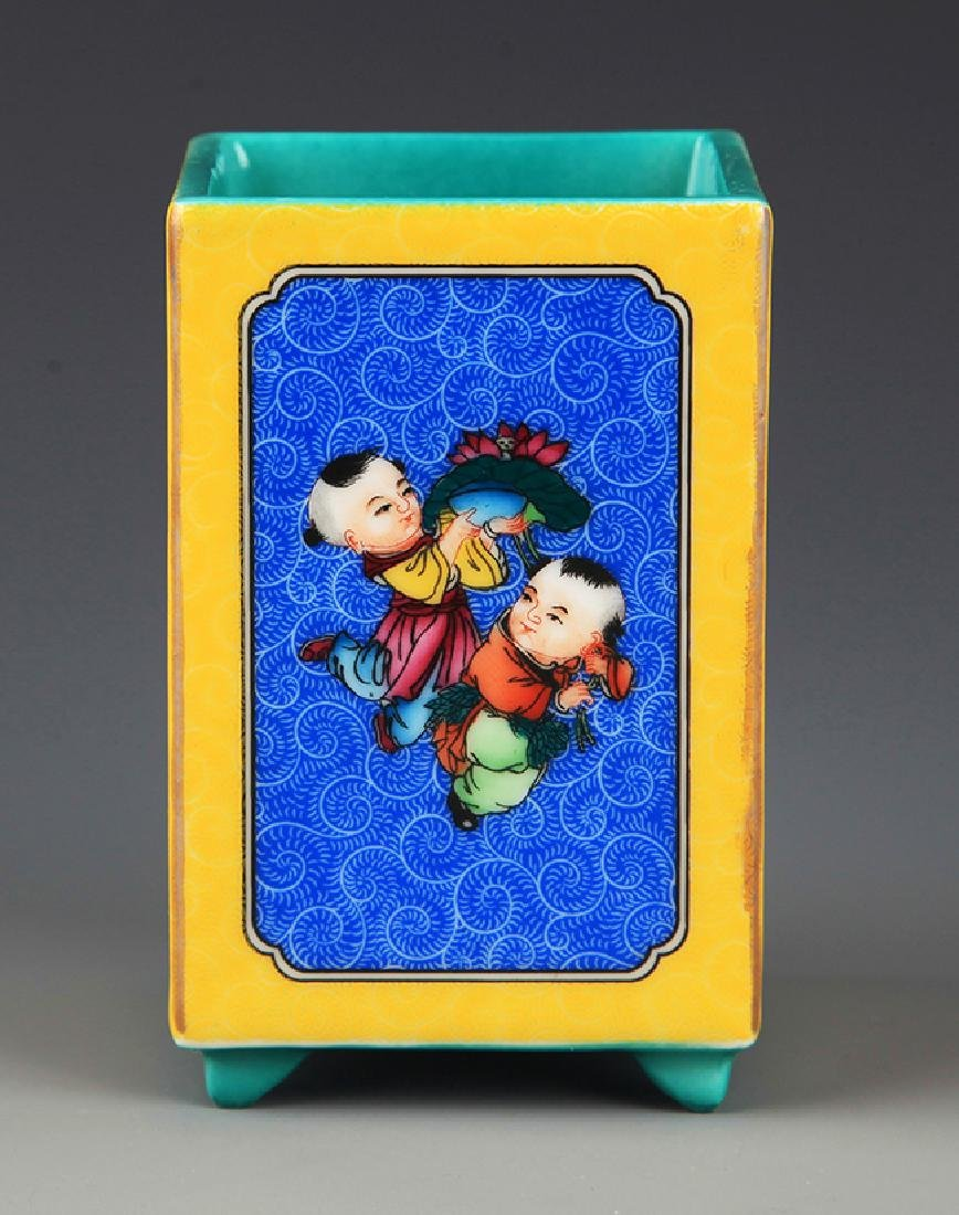A FAMILLE-ROSE BOY PAINTED PORCELAIN BRUSH POT