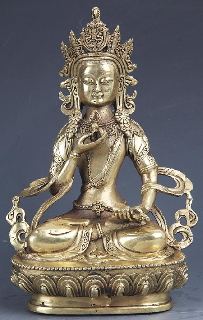 A FINELY CARVED TIBETAN BRONZE BUDDHA MODEL