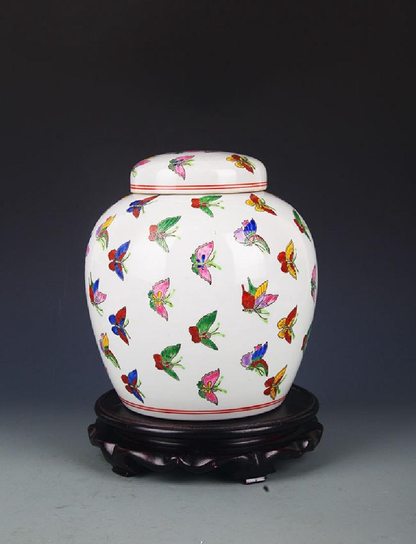 A FINE FAMILLE ROSE BUTTERFLY JAR WITH COVER