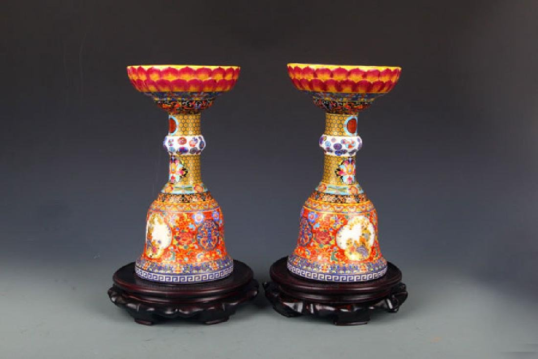 PAIR OF FAMILLE ROSE BIRD PAINTED CANDLESTICKS